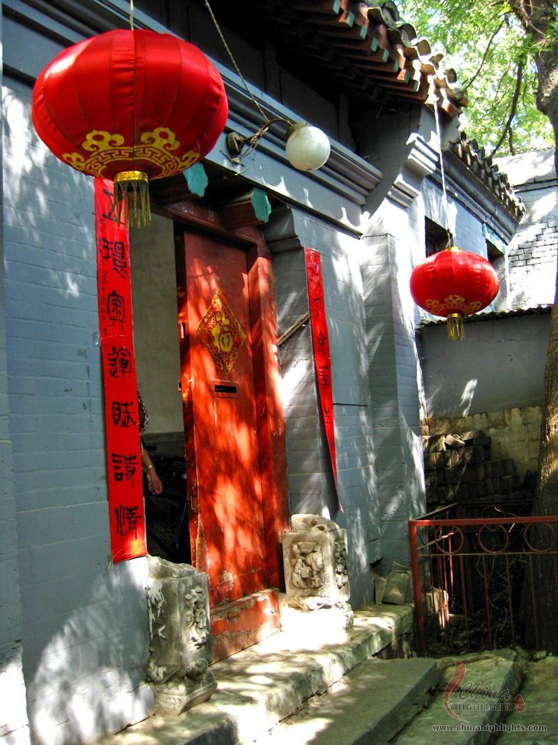 A Red Gate with Couplets
