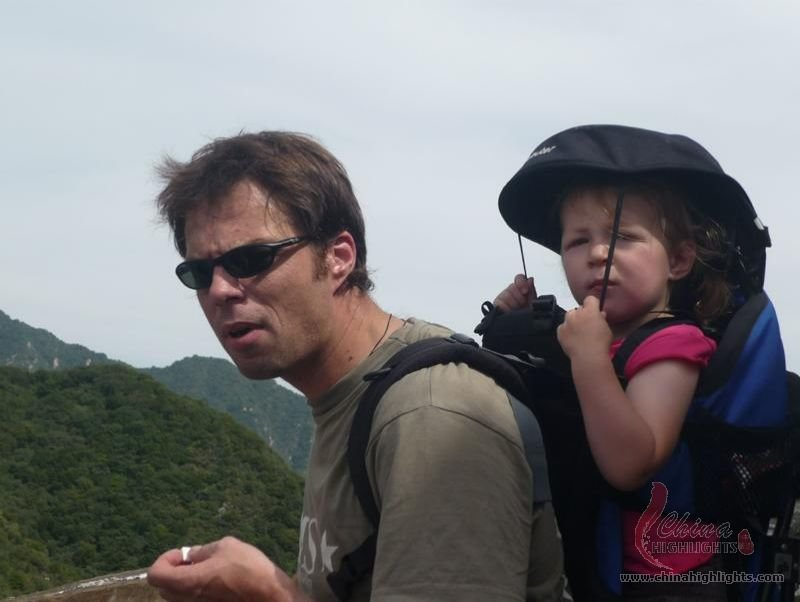 Cool man lovely baby on the Great wall.